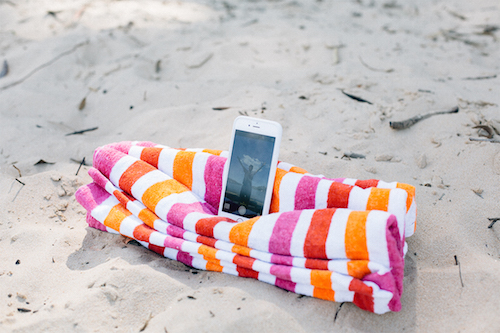 Selfie-mergency! Here's a hack for taking selfies at the beach. You can get your face, the water, and your whole body in the shot by folding a beach towel like this and using it to prop your phone. Must try!