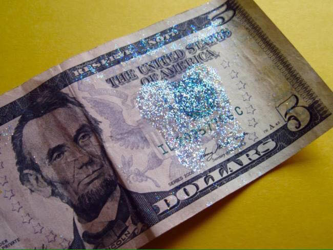 Make removable glitter tooth fairy wings using glitter glue! Glitter glue doesn't get glitter everywhere and it's temporary so you can peel it right off of the money. Great idea! Click the picture to get some of this glitter glue.