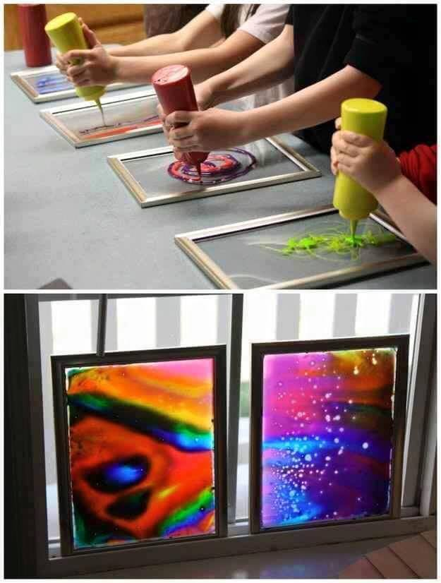 Make colorful window art using glue and food coloring!