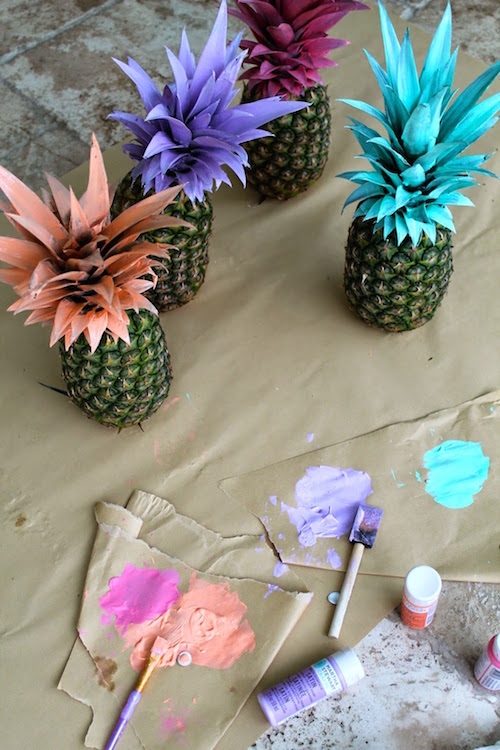 Painted pineapples - a fun DIY idea for kids or even a DIY summer party decor idea. So colorful, so creative, and so easy!