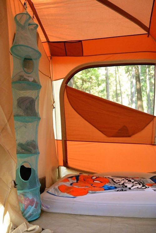 A hanging closet organizer will keep your tent organized. A must have for kids!