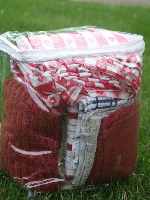 Buy the Dollar Store bedding bags to keep towels, etc together, and keep camp dust off while camping. So smart!