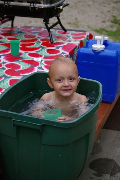 Bring an extra large camping tub, fill it with water, and use it as a bathtub for little kids. Great idea!