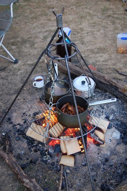 Use a camping tripod for cooking over a campfire. Great idea!