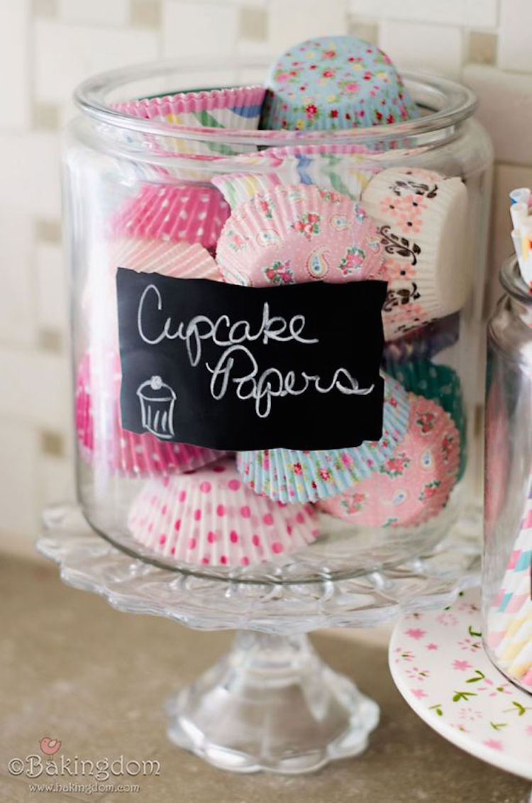 Store cupcake wrappers in a large glass jar on top of your cake plates. Everything is in its spot! So smart.