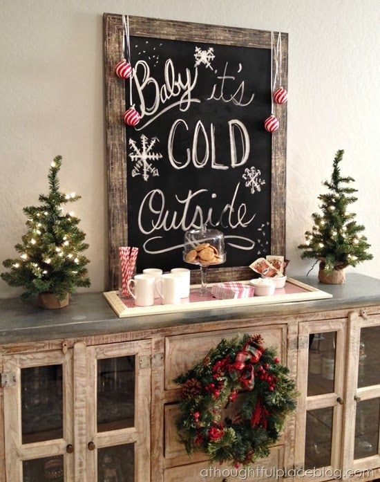 Rustic chalkboard with holiday sayings. Perfect! I love the hot chocolate setup below it.