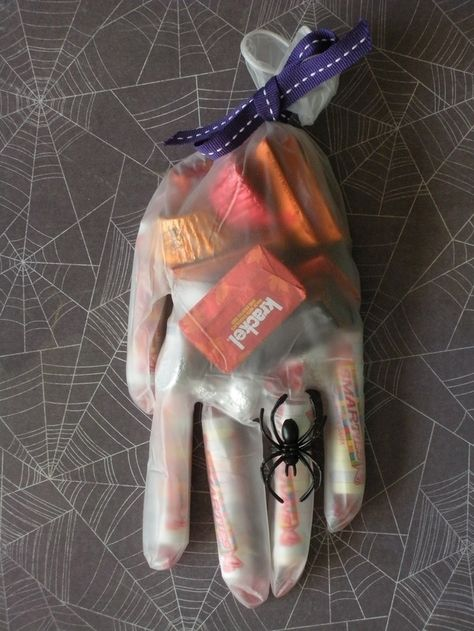 This is a super easy way to spookily bag your candy: in a vinyl glove. Add a spider ring, too