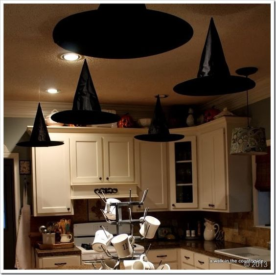 Floating witchs' hats for halloween party. Great kitchen Halloween decor too!