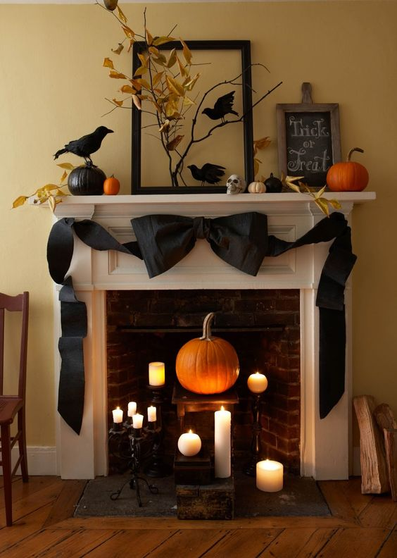 Gorgeous gigantic black bow across a fall mantle. This bow is made out of crepe paper!
