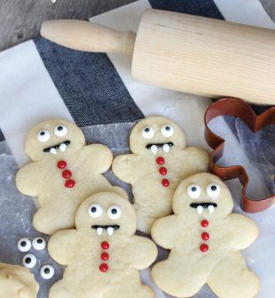 How to make Vampire Cookies in 30 seconds for Halloween! Use a gingerbread man cookie cutter... SO SMART and they look perfect every time.