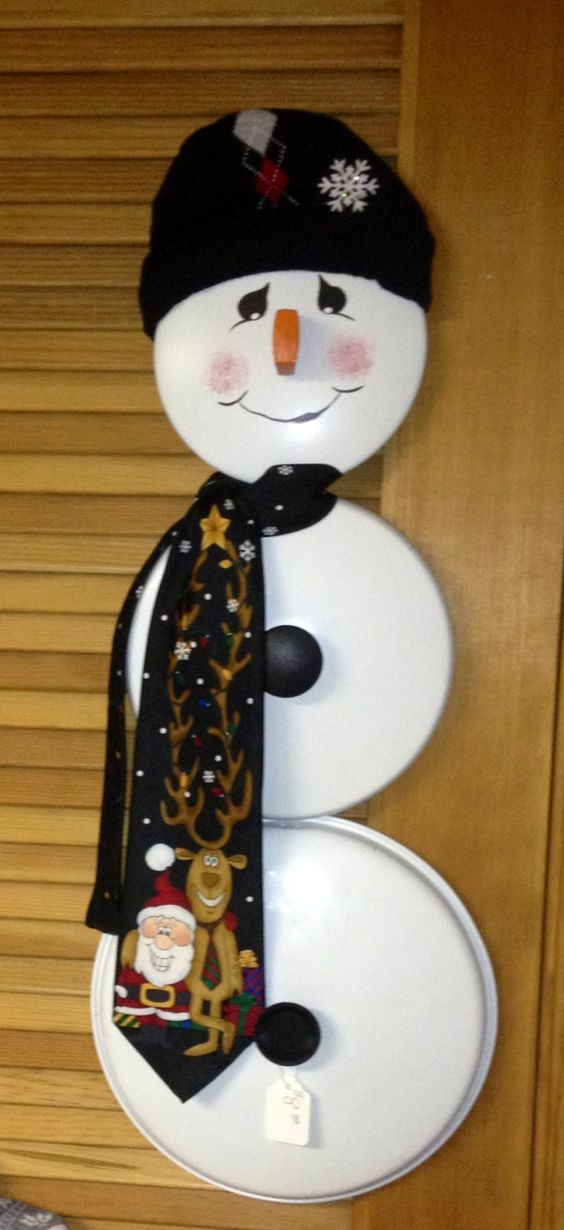 Snowman made out of pot and pan lids