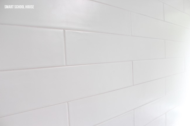 Gray and white bathroom ideas. Long white matte subway tiles in the shower.