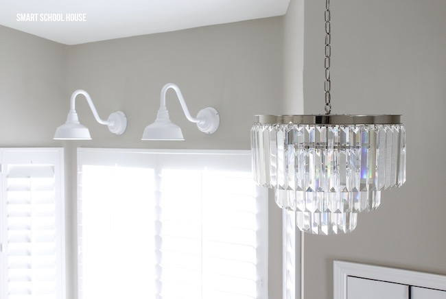 Crystal chandelier and farmhouse lights. Mixing glamorous and rustic for that perfect look!