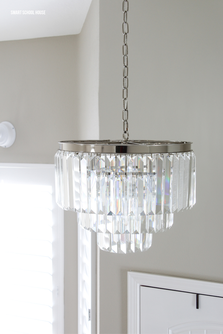 Crystal chandelier and gray paint. Mixing glamorous and rustic for that perfect look!
