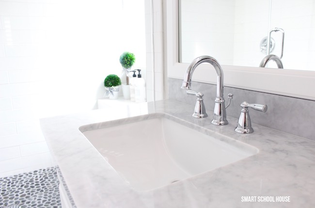Gray and white bathroom ideas. Marble countertops and farmhouse inspired sink faucet for the bathroom.