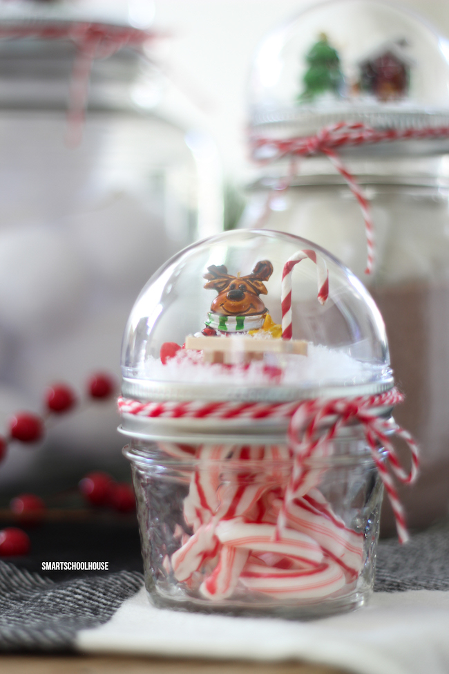 how to make a mason jar lid snow globe for christmas using a clear plastic ornament
