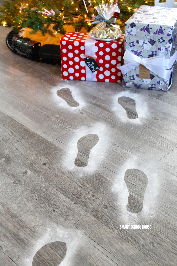 Santa Footprints - how to make Santa's footprints using baking soda for Christmas. ADORABLE! It takes seconds to do and just a minute to clean up.