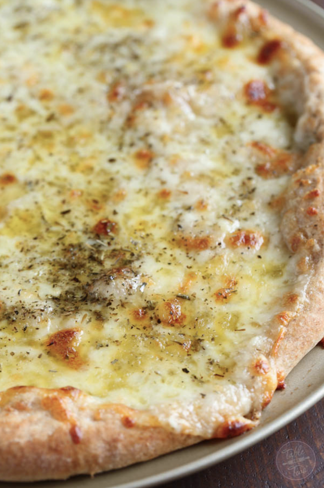 20 minute White Pizza recipe. A classic white pizza with a whole-wheat blend crust is the perfect cheesy, oily, and garlic-y pizza for any day of the week!