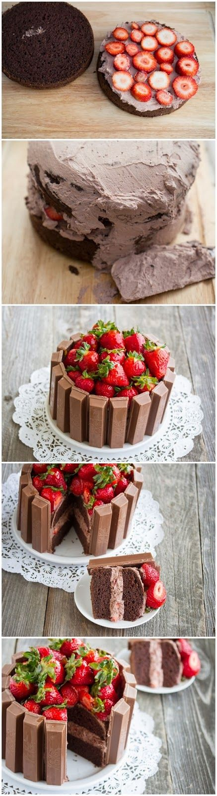 """I baked a regular chocolate cake, sliced it in half, did a chocolate whipped cream and fresh strawberries filling, then spread more whipped cream outside the cake before sticking on the kit kats and topping with piles of fresh strawberries."""