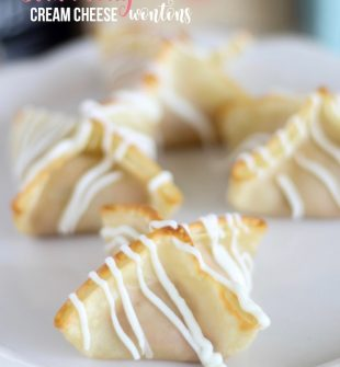 Strawberry Cream Cheese Wontons - sweet and fluffy strawberry cream cheese mixed with buttery soft baked wonton flavor then drizzled in white chocolate.
