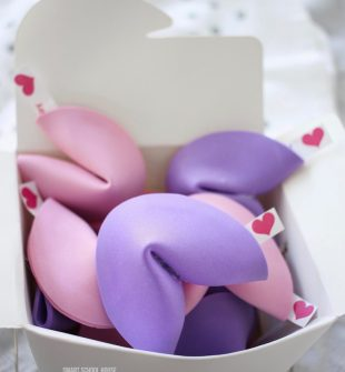 How to Make Valentine Fortune Cookies - DIY pink and purple fortune cookies for Valentine's Day! An easy candy free and non-food Valentine idea.