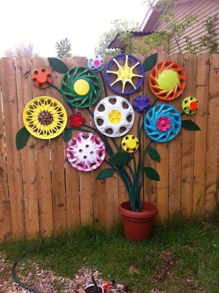 Hubcap flower garden - such a cute idea!