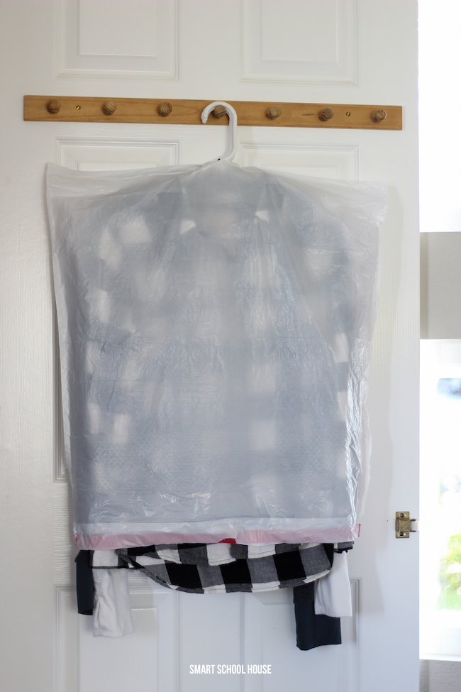 Protect winter clothes in the closet with trash bags. This works great for moving too!