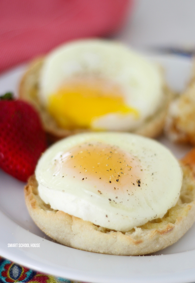 Recipe for baking eggs in a mason jar lid. SO EASY and for busy mornings or feeding a large family. The baked eggs slide right out! I would put mine over an english muffin. Recipe for making mason jar lid eggs in the oven