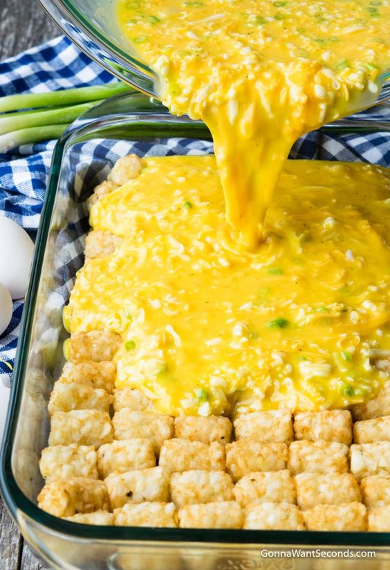 Tater Tot Breakfast Casserole - Our Easy Tater Tot Breakfast Casserole takes minutes to assemble and the result is a dish that's perfect for family breakfast, fancy brunch, or a church potluck!
