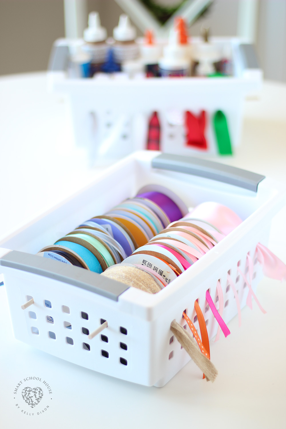 Ribbon Storage in a Basket - For this, I used plastic bins with small wooden dowels. It's ribbon perfection I tell you!