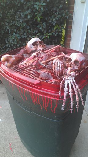 Make a trash can look like it is filled with bones and blood. Use a trash can, skeleton bone parts, Great Stuff Foam, and spray paint in red and mahogany lacquer.