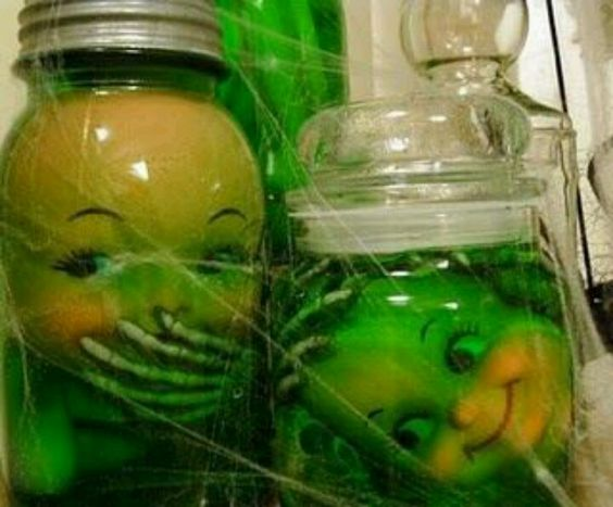 Take old doll parts, add some skeleton parts, fill jar with water, and add green food coloring. Awesome!