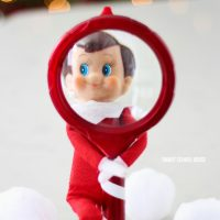 Elf on the Shelf with a Magnifying Glass