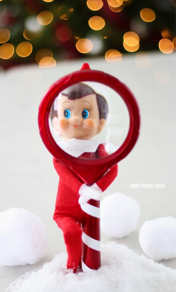 He's always watching! How to make an Elf on the Shelf looking through a Magnifying glass for Christmas. #ElfOnTheShelf #ElfOnTheShelfIdea #ElfOnTheShelfIdeas #EasyElfOnTheShelfIdea