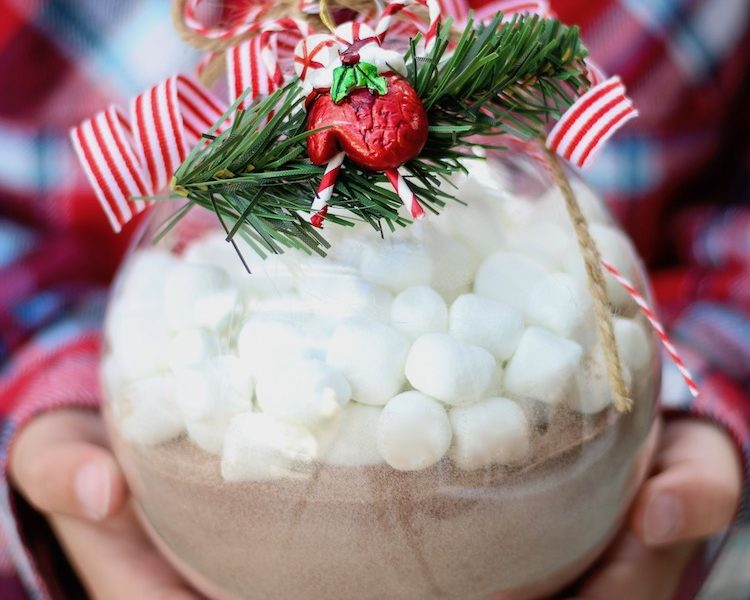 Ornament filled with Hot Chocolate - mix hot cocoa in a large plastic ornament then add mini marshmallows on top for a quick and easy DIY Christmas gift.
