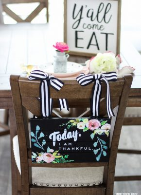 Y'all Come Eat sign with an adorable rustic place setting and hanging chair sign #farmhousedecor #farmhousekitchen #farmhouse table #yall #tablescape #hangingchairsign #homedecor #diyhome #easter #spring #brunchtable