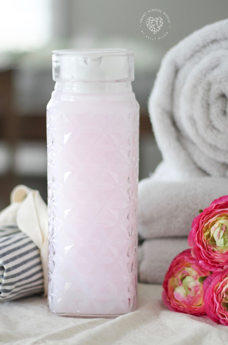 Homemade fabric softener with conditioner. IT WORKS! This has saved me so much money and my laundry SMELLS SO GOOD! #fabricsoftener