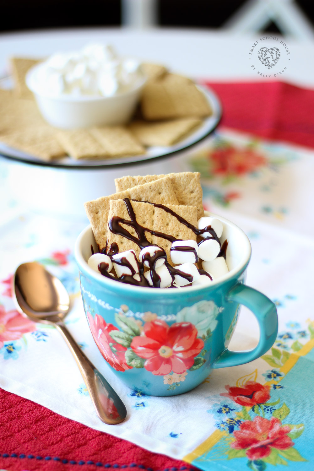 S'mores mug cake! Triple chocolate cake topped with graham crackers, marshmallows and chocolate. Takes less than 1 minute to make!