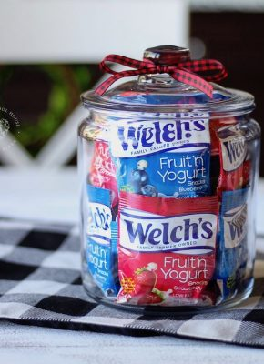Fruit Snacks in a Jar - colorful fruit snack bags stacked in a clear jar for easy access and pretty organization of kids' snack food.