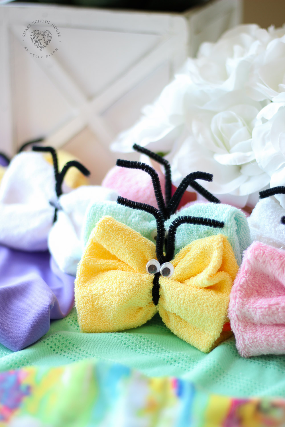 Step by step visual instructions teaching you how to make washcloth butterflies. An adorable and easy craft idea for kids too! #washclothanimals #washclothcraft #craftideasforkids