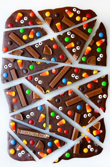 Quick, easy and ghoulish Halloween Candy Bark made with Kit Kats, M&Ms, and Candy Corn