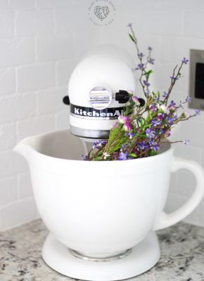 Flowers in a Kitchen Aid mixer. A simple and easy way to add color and character and charm to a stand mixer! #kitchendecor #farmhousedecor #farmhousestyle