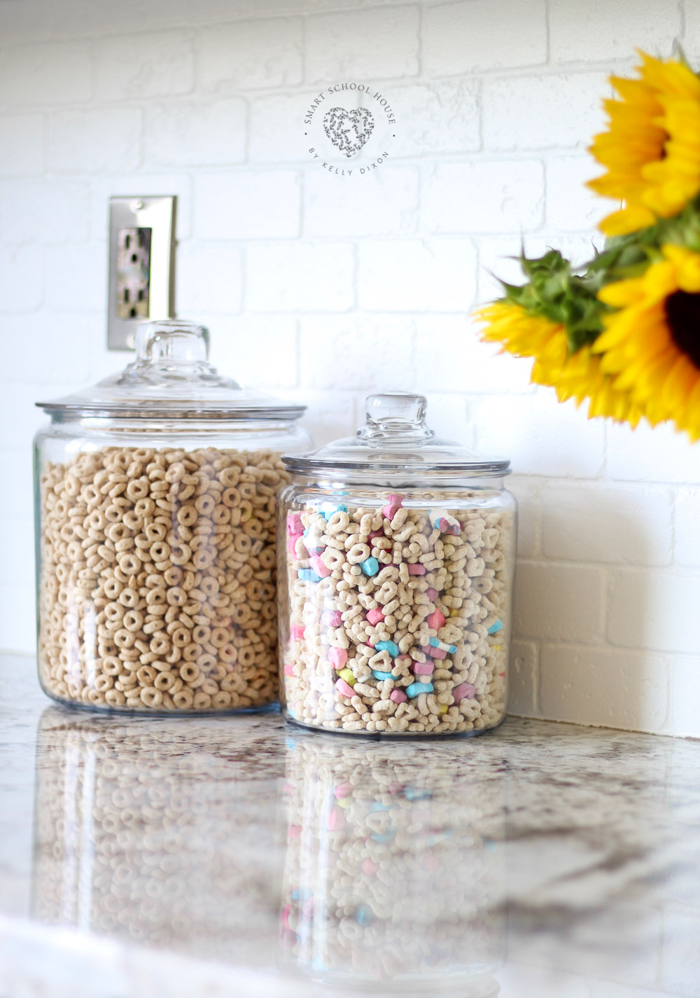 Cheerios and Lucky Charms in glass jars on my kitchen counter. Adds a warm, charming, and kid friendly energy to our family kitchen