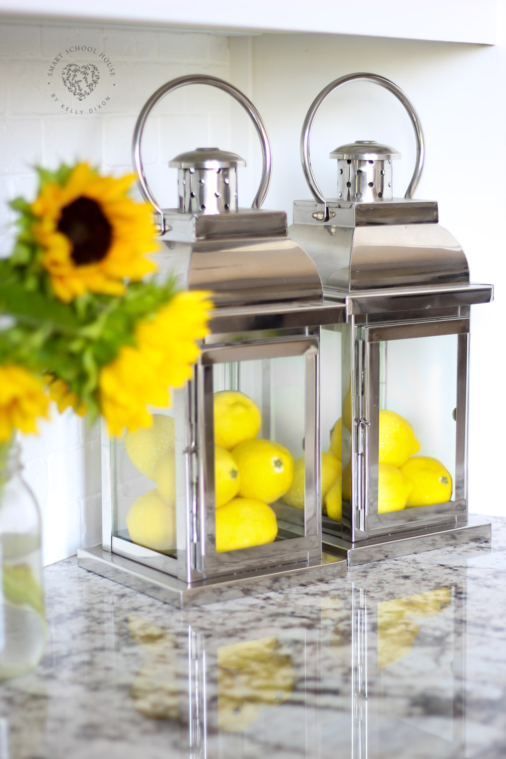 Decorating with lanterns in the kitchen. Lemons, lanterns, and sunflowers. Change the lemons out depending on the season! #DIYhomedecor #farmhousestyle