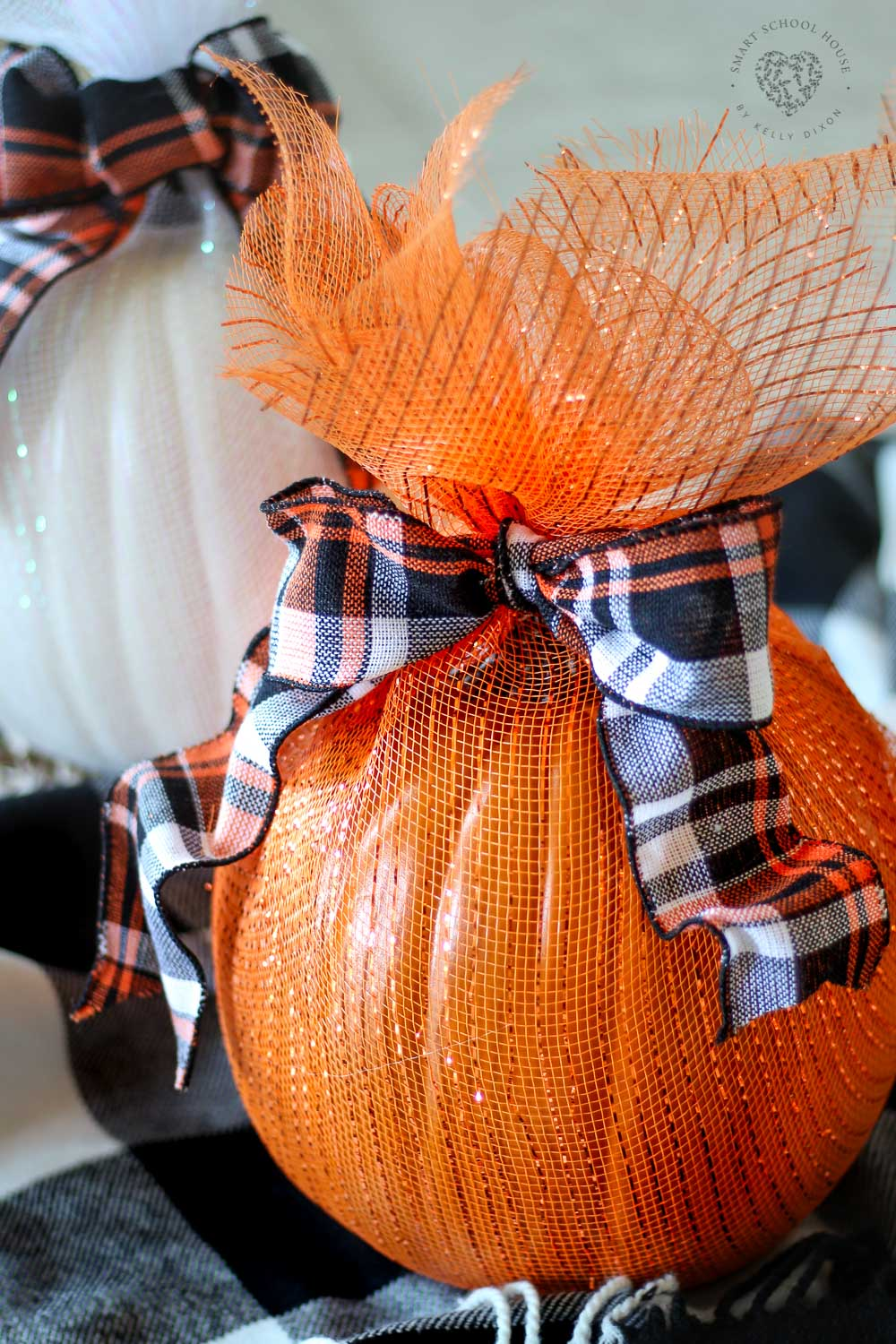Pumpkins Wrapped in Mesh. A no-carve pumpkin decorating idea!I love how the pumpkins sparkle and look all dressed up without any carving. #pumpkindecor #decoratingwithpumpkins #DIYHalloweenDecorations #DecoMeshPumpkin