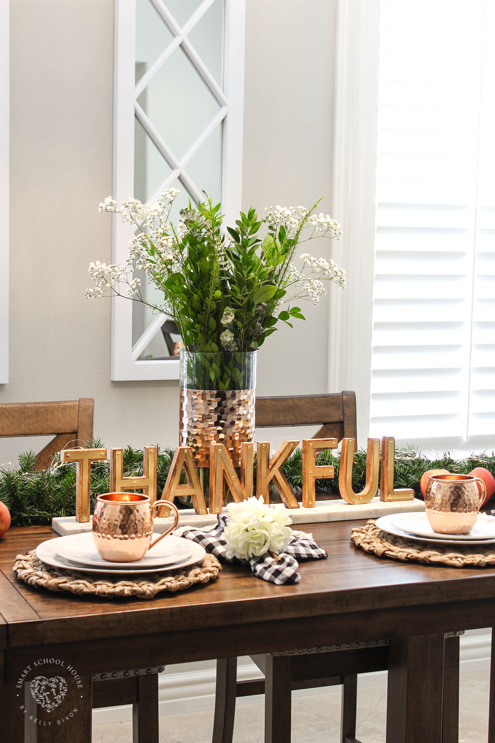 Fall tablescape idea. DIY fall table decor. Thankful sign, marble plates, and thankful sign. Buffalo check napkin with floral napkin rings. #falldecor #falltablescape #homedecor