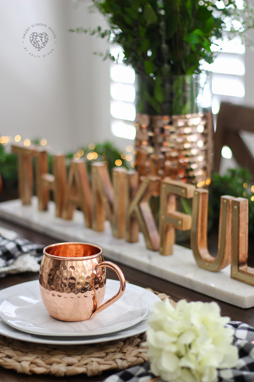 Fall tablescape idea. DIY fall table decor. Thankful sign, marble plates, and thankful sign. Buffalo check napkin with floral napkin rings. #falldecor #falltablescape #homedecor