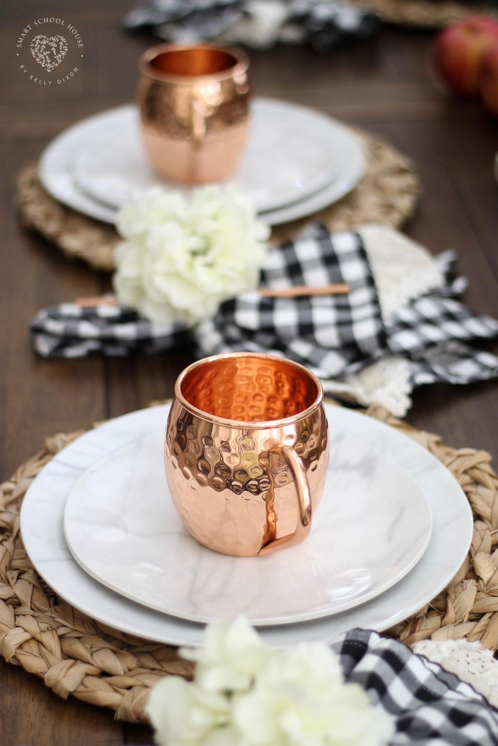Fall tablescape idea. DIY fall table decor. Moscow mule mugs. Marble plates. Buffalo check napkin with floral napkin rings. #falldecor #falltablescape #homedecor