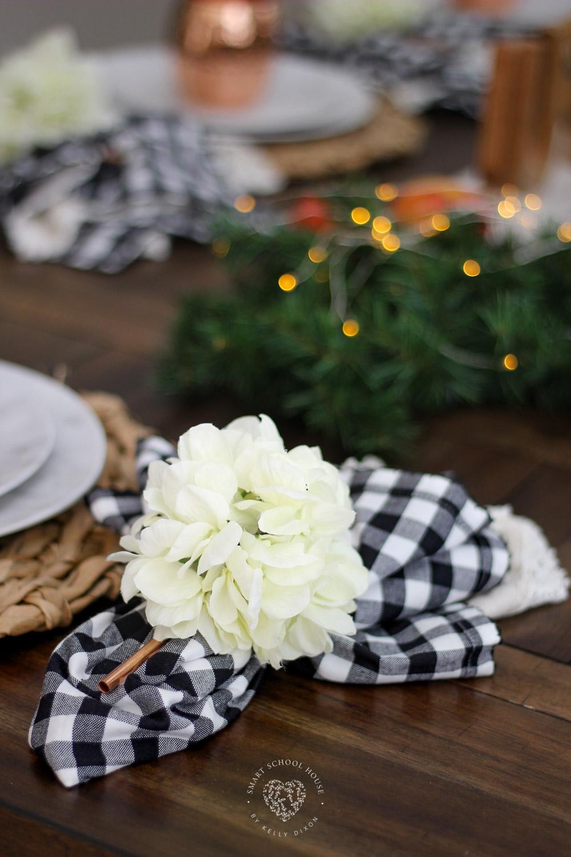 Buffalo check napkins with copper straw and floral napkin rings. #falldecor #falltablescape #homedecor