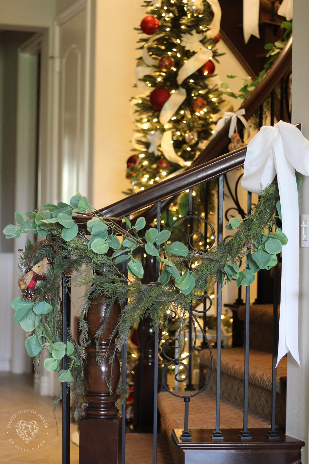 Eucalyptus Garland for Christmas tied with white ribbons. Simple and beautiful garland idea for Christmas. #ChristmasGarland #EucalyptusGarland